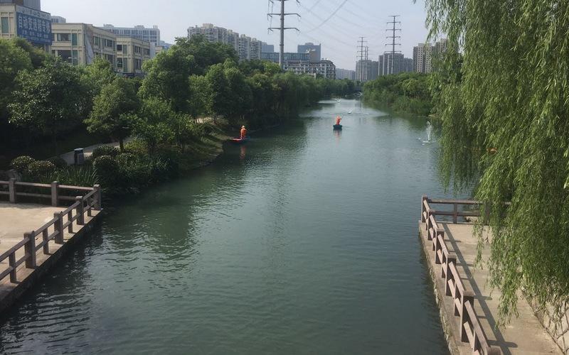 如今的十字港河碧波荡漾,风景怡人。